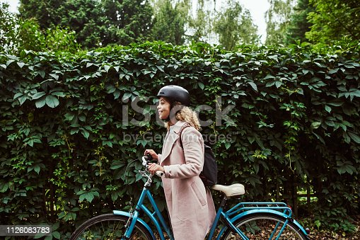 Cropped shot of an attractive young woman out for a cycle through the woods