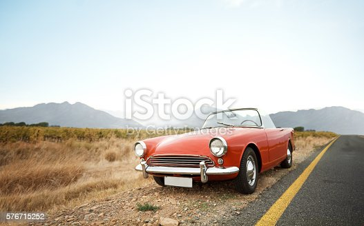 Shot of a vintage car parked on the side of the road