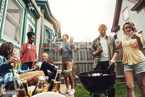 istock Life's greatest pleasures - friends and food 881470732
