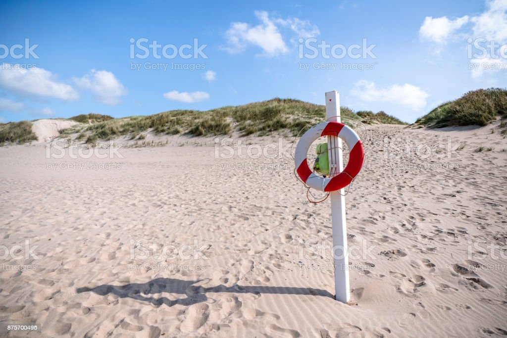 Lifesaver hanging on a post stock photo