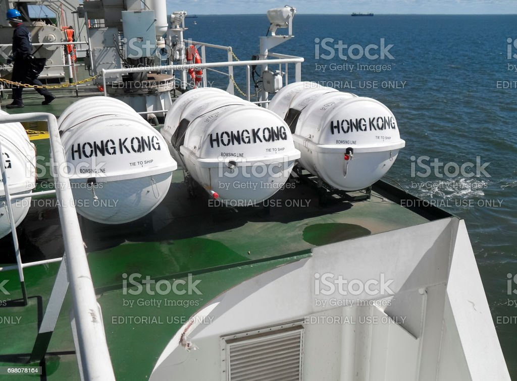 Life-saving inflatable rafts on the ship's deck. White rescue drums with inflatable rafts. stock photo