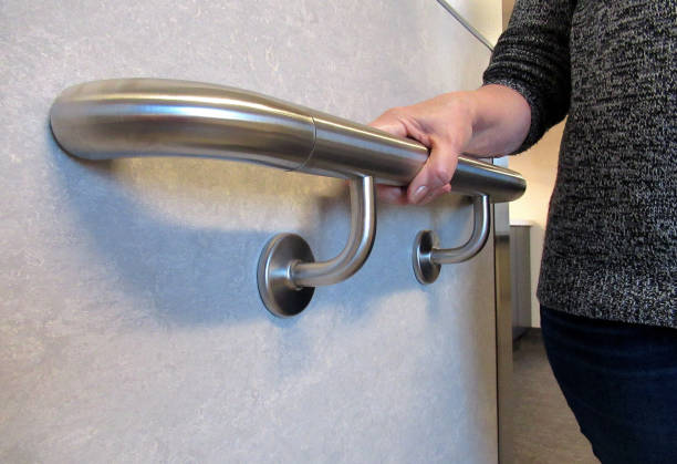 "lifestyle, ""a wall mounted hand rail support"" - geländer stock-fotos und bilder"