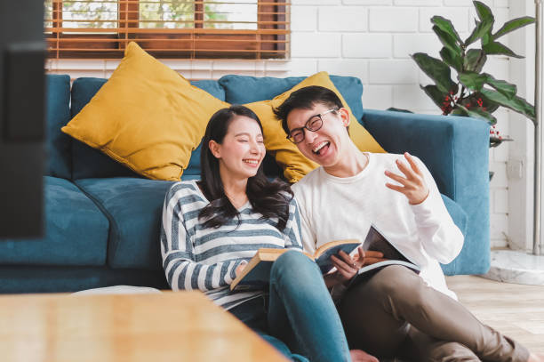 Lifestyle Asian couple man and woman talking working  spend time together at home, Asian couple family lifestyle concept stock photo