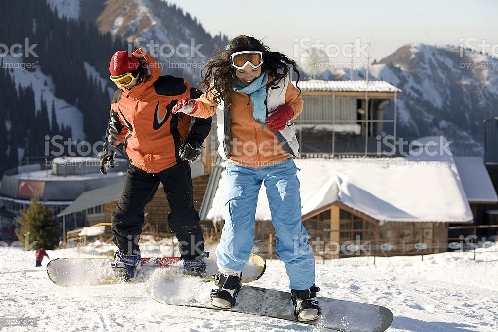 Lifestyle image of two young adult  snowboarders stock photo