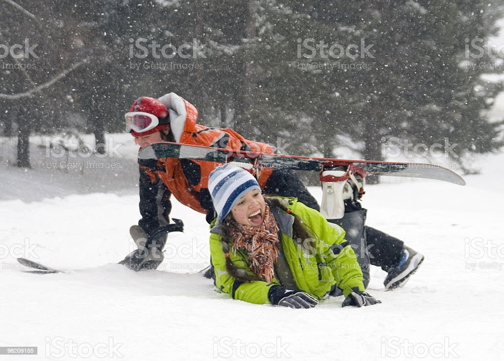 lifestyle image of two young  snowboarders royalty-free stock photo
