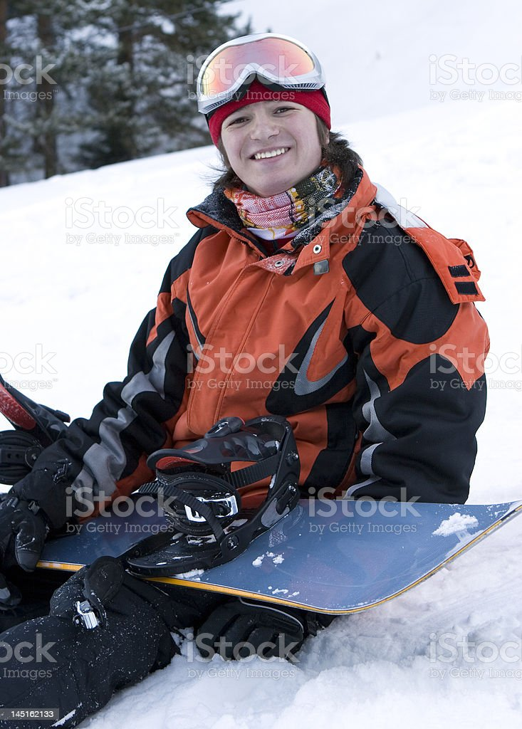 lifestyle image of young adult snowboarder royalty-free stock photo