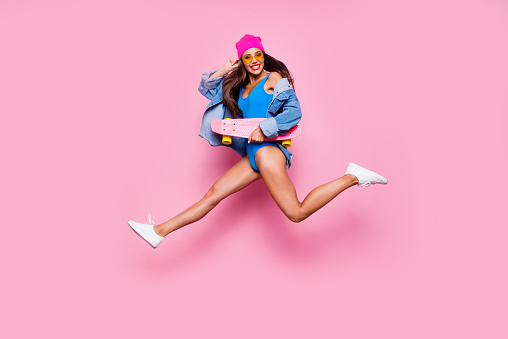 Lifestyle leisure dream dreamy person people concept. Side profile full length size studio photo portrait of funny funky cheerful careless beautiful cool girl jumping up isolated bright background