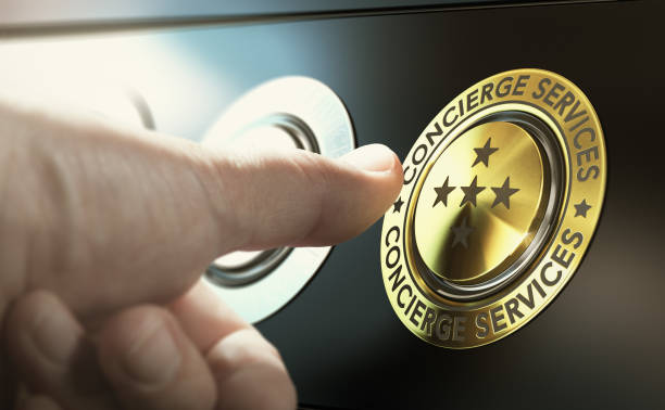 Lifestyle Management and Concierge Services Man contacting concierge service by pushing a golden button. Composite image between a hand photography and a 3D background. concierge stock pictures, royalty-free photos & images