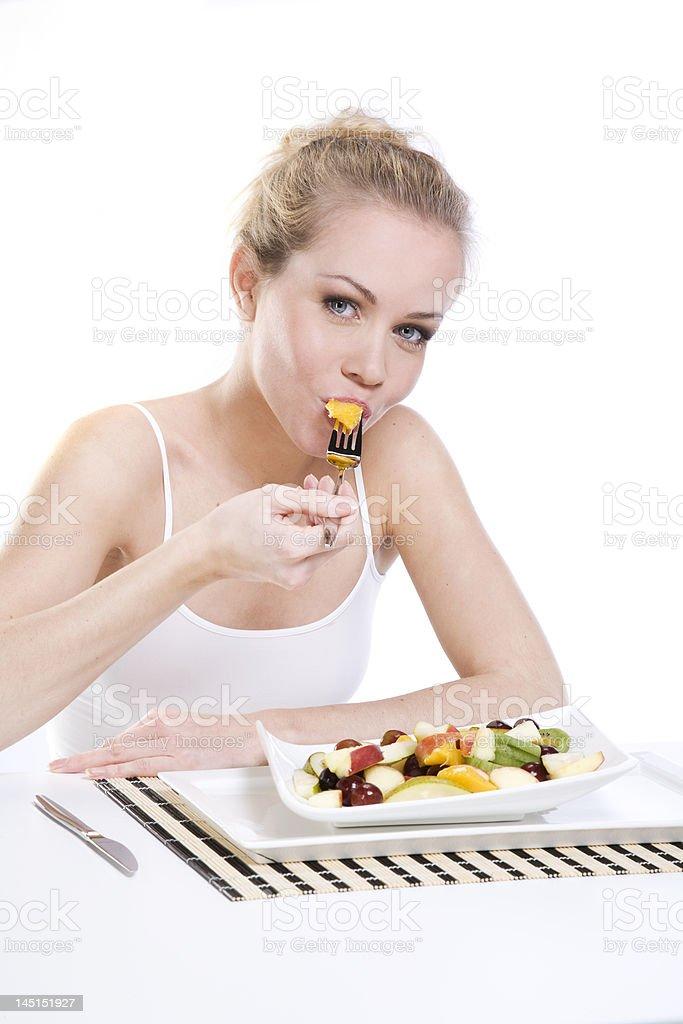 Lifestyle model eating fruit royalty-free stock photo