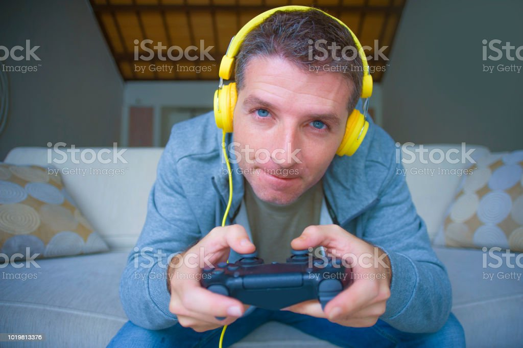 Lifestyle Portrait Of Young Happy And Excited Gamer Man With