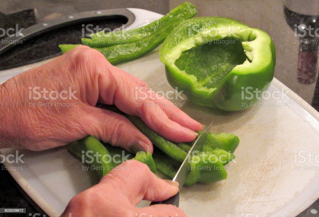 Lifestyle, Preparing Green Peppers stock photo