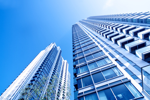 Residential Skyscrapers with diminishing perspective, Trees and clear sky backdrop