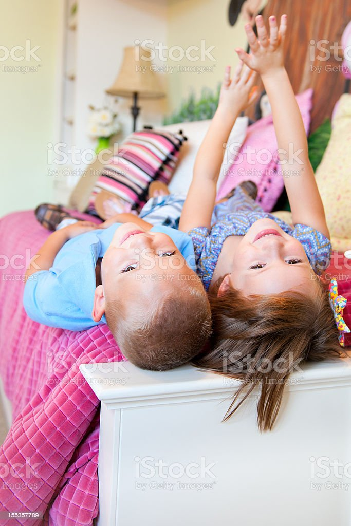 Lifestyle Series: Adorable Children Laying in Bed stock photo