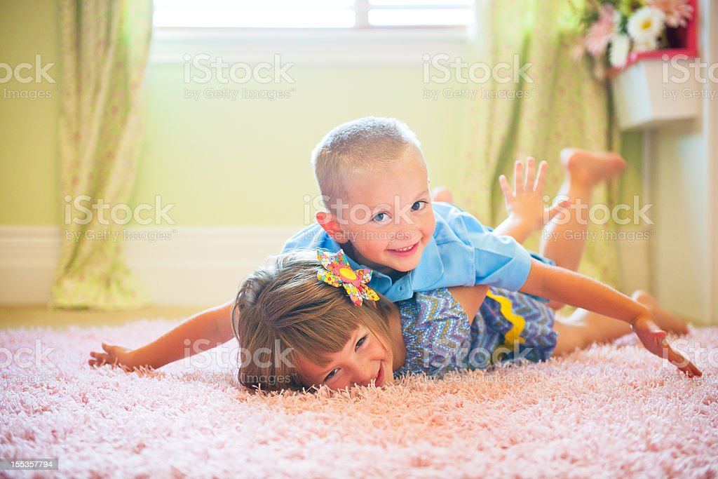 Lifestyle Series: Brother and Sister Playing in Bedroom stock photo