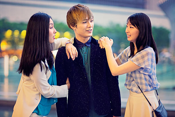 Lifestyle session Two young Japanese girls are fighting for a boy in one classical love triangle. asian love triangle stock pictures, royalty-free photos & images