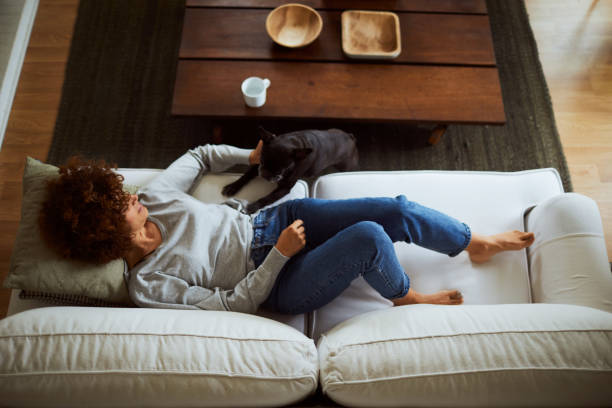 Lifestyle woman with a french bulldog relaxing in living room picture id1061363352?b=1&k=6&m=1061363352&s=612x612&w=0&h=eftm8fa mmi9iym5ugbqio1sqcb 8uyzjpwpgdtbxws=