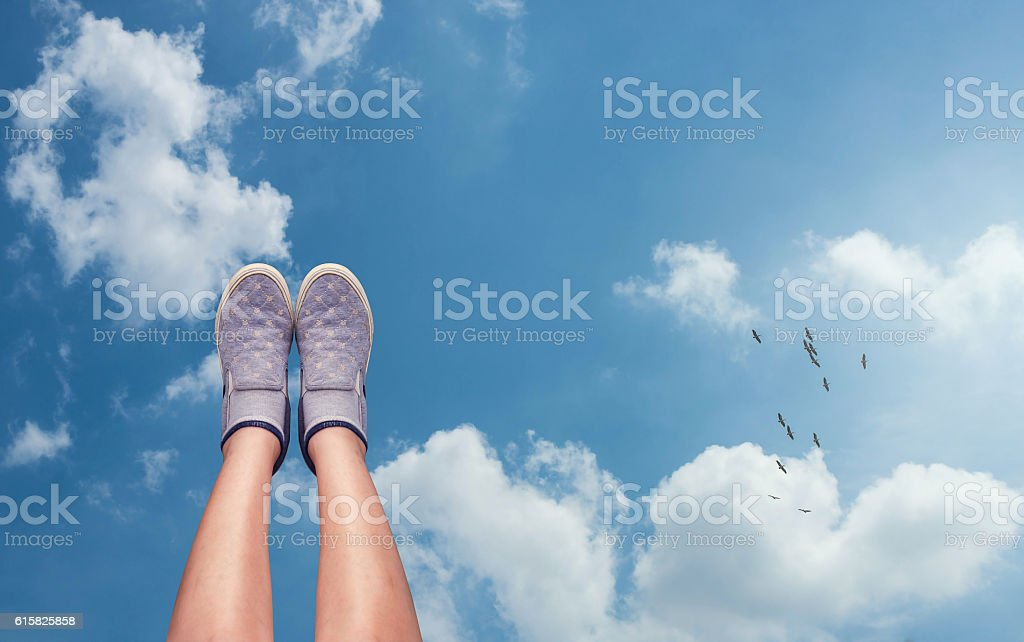 Lift shoes pointing up in the sky stock photo
