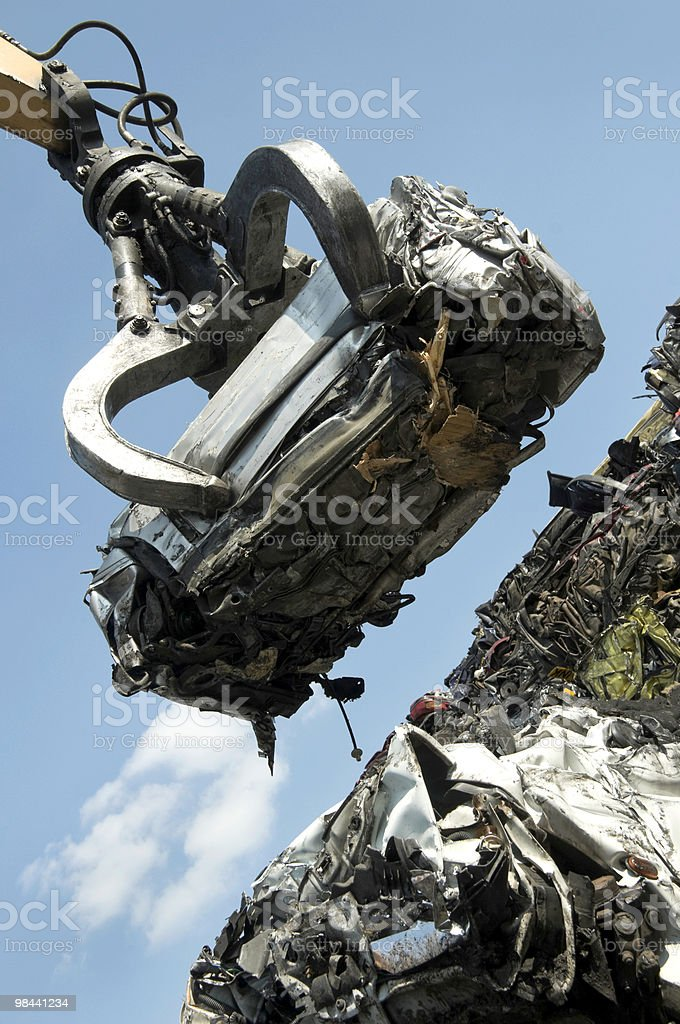 Lifted scrap car stock photo