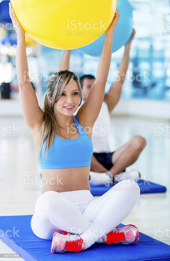 Lifting a fitness ball royalty-free stock photo