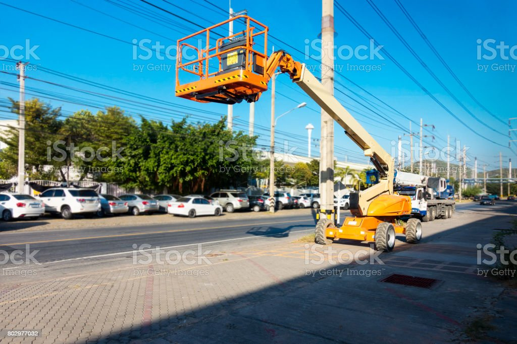 Lifting boom lift in construction site. stock photo