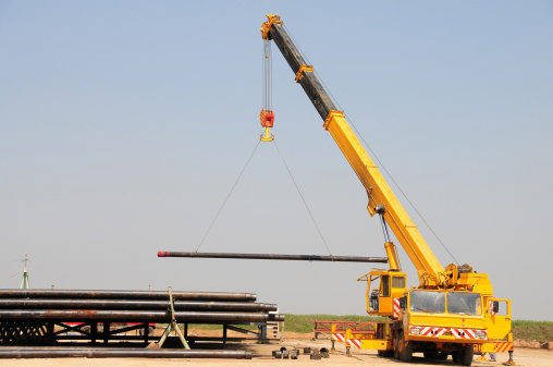 A lifting crane which is used to carry heavy loads in the oil and gas industry.