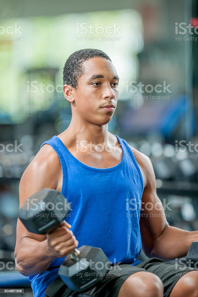 Lifting Dumbbells at the Gym stock photo
