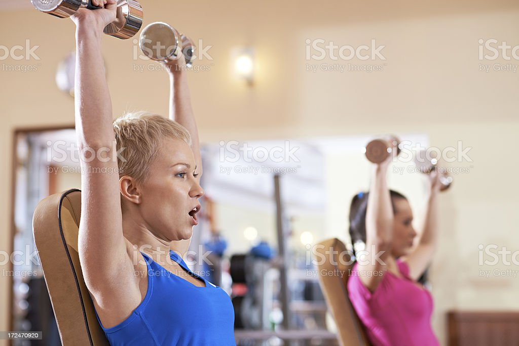 Lifting dumbbells royalty-free stock photo