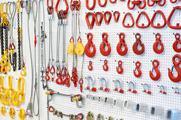 Lifting equipment, hooks and chains Lifting equipment and chains in exhibition store rigging stock pictures, royalty-free photos & images