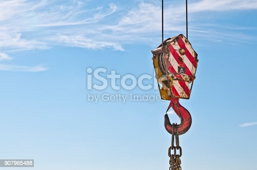 istock Lifting hook crane and chain links. Lifting hook for heavy loads. 907965488