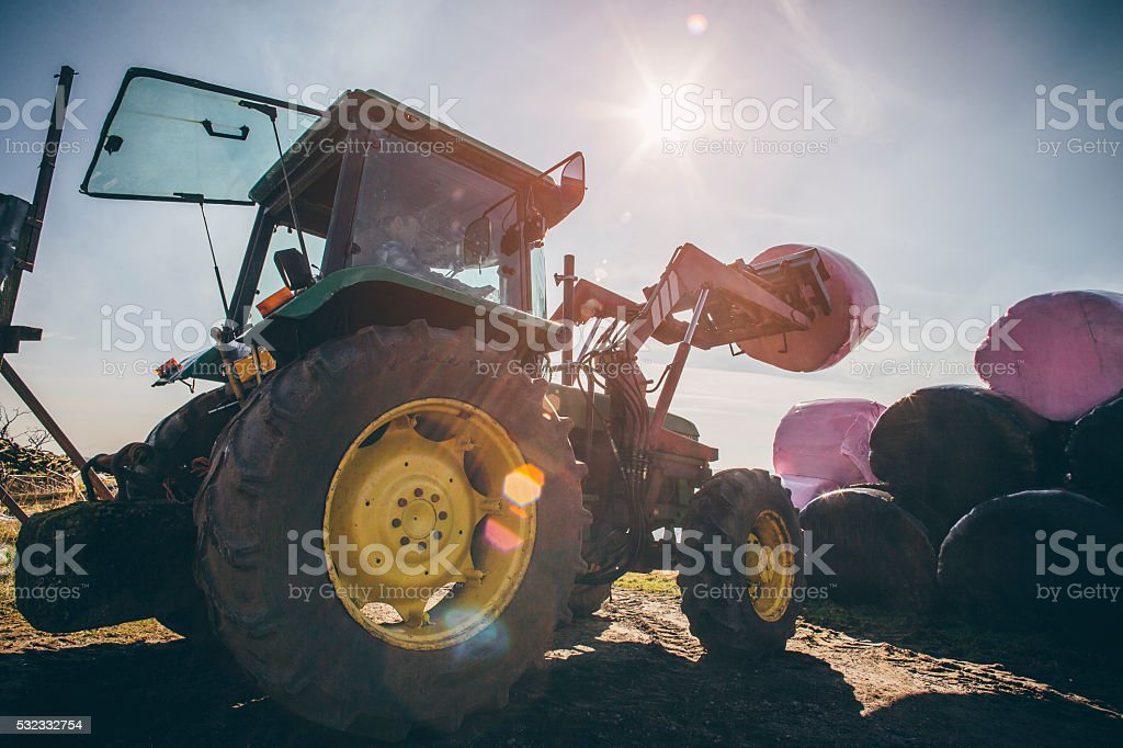 Lifting Silage Bales stock photo