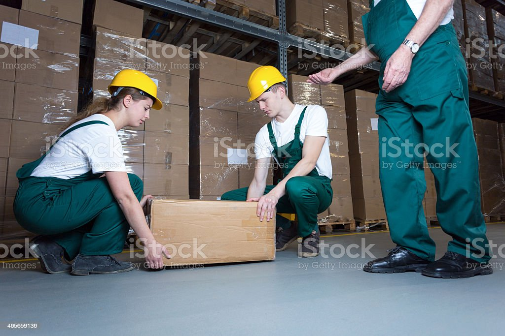 Lifting the box stock photo