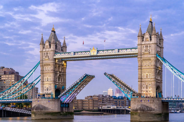 Lifting up London Tower Bridge London Tower Bridge lifting up at Sunset dusk, London UK. bascule bridge stock pictures, royalty-free photos & images