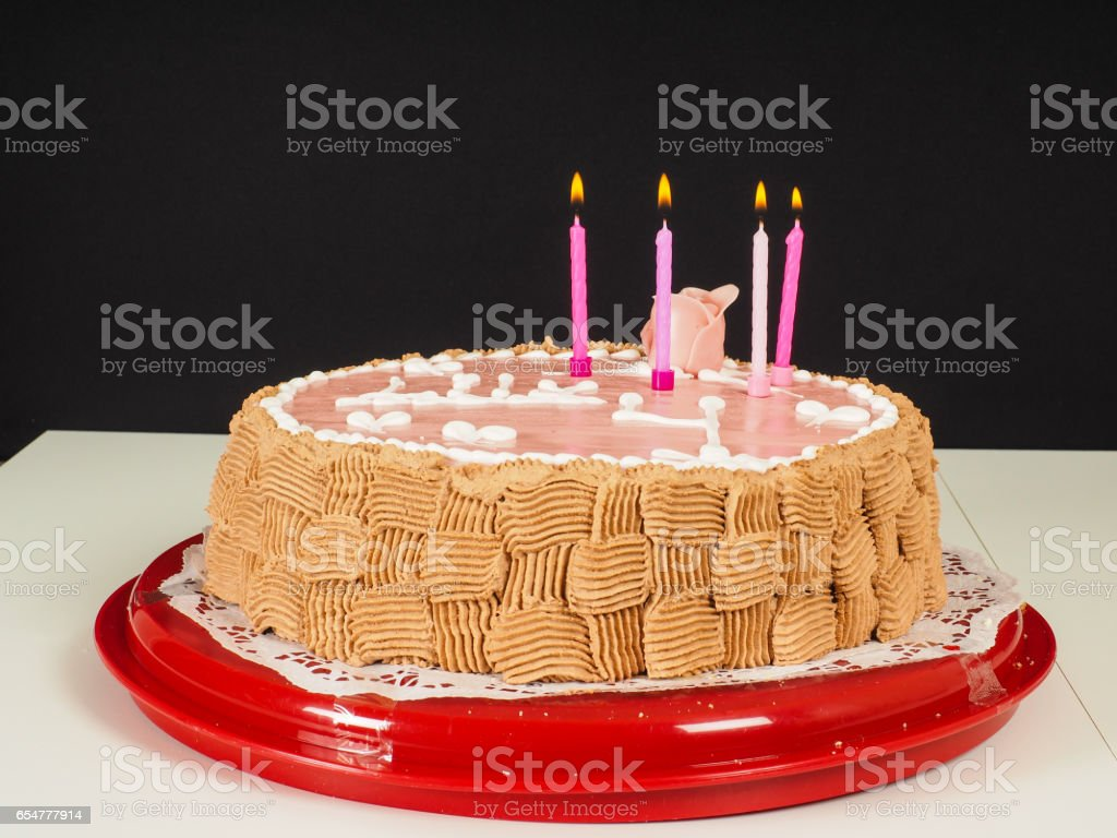 Lig Candles On A Pink Marzipan Covered Birthday Cake With Rose And Beautiful Chocolate