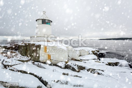 Lighhouse at Baltic sea coast in winter, Sweden