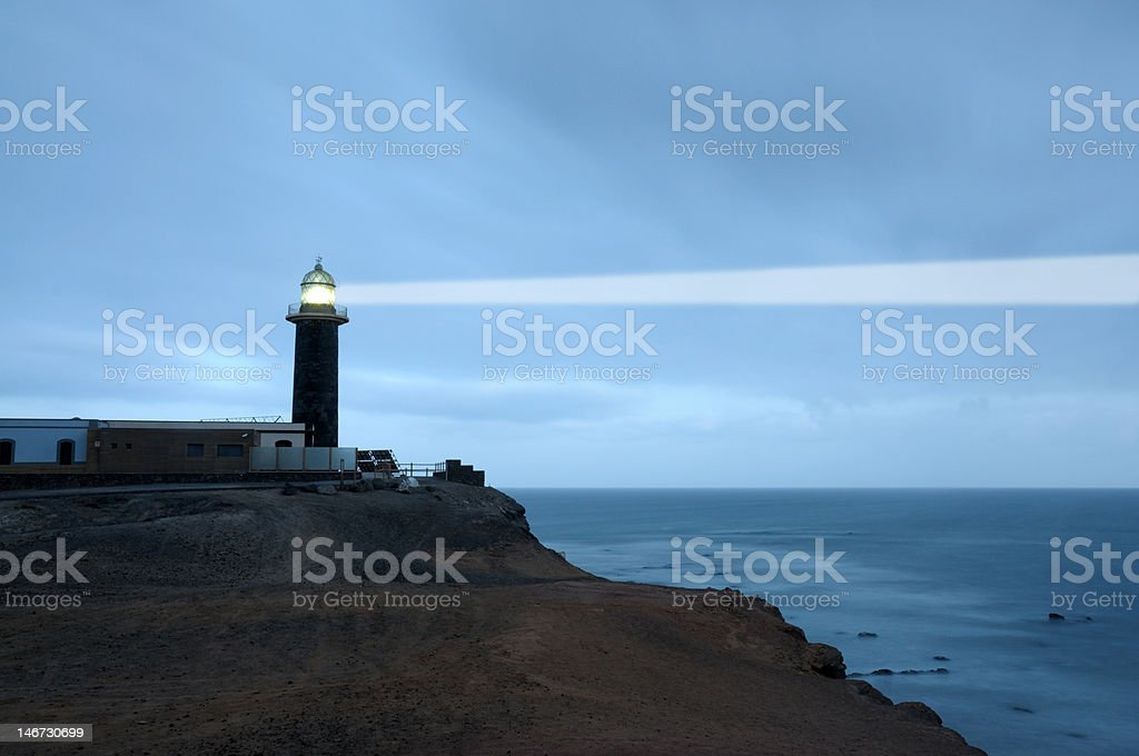 Lighhouse searchlight beam stock photo