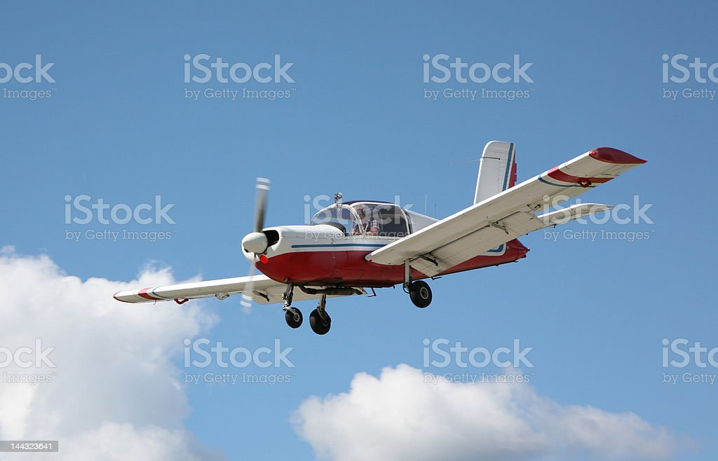 Light aircraft in landing pattern royalty-free stock photo