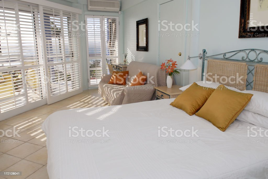 Light and airy bedroom of a weekend retreat royalty-free stock photo