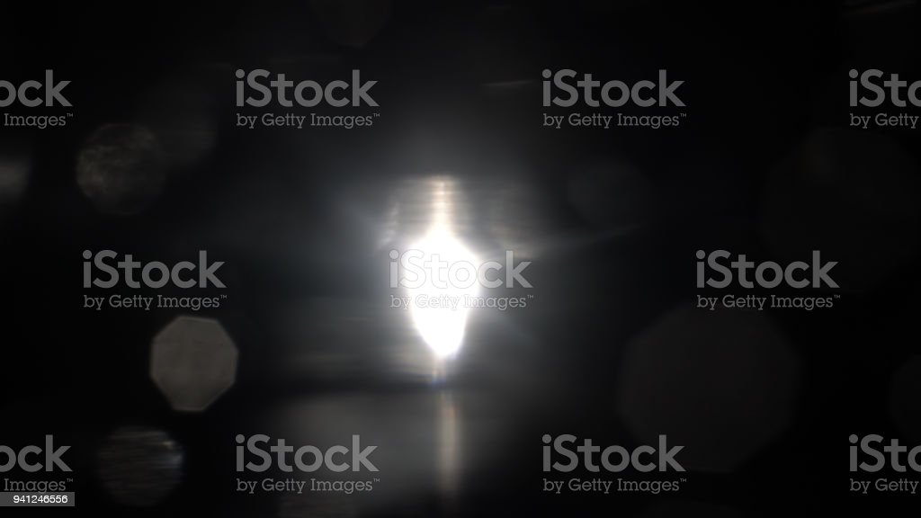 Light and blurred flares on black stock photo