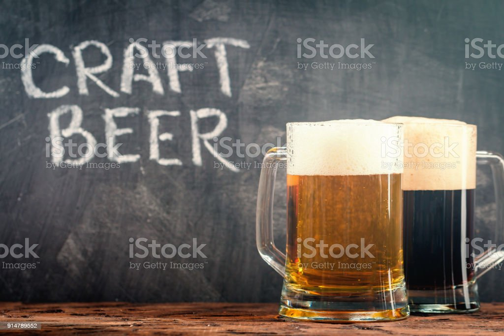 light and dark beer stock photo