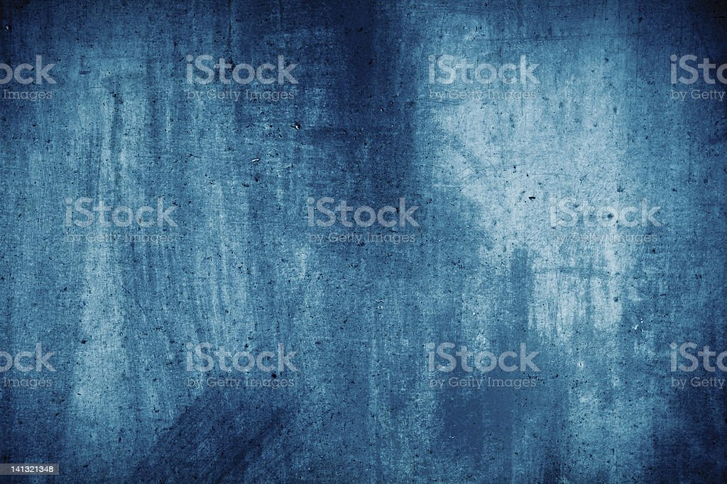 A light and dark blue grunge wall texture stock photo