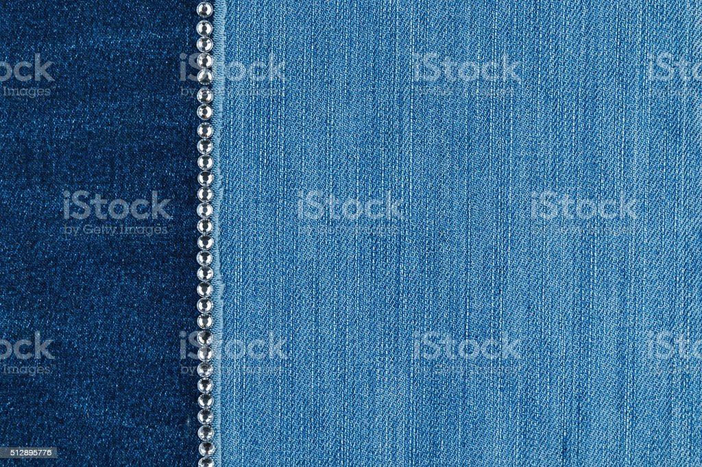 Light and dark jeans with silver rhinestones stock photo