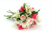 Light and dark pink rose bouquet isolated on white.