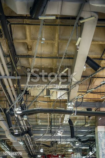 1071156490 istock photo light and pipe of air conditioner above the store 1072163770