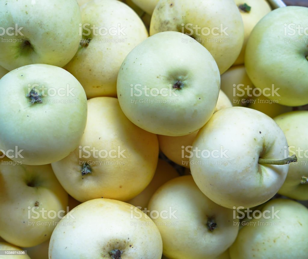 Light apples in a box. an ecological product for vegetarians. Stock...