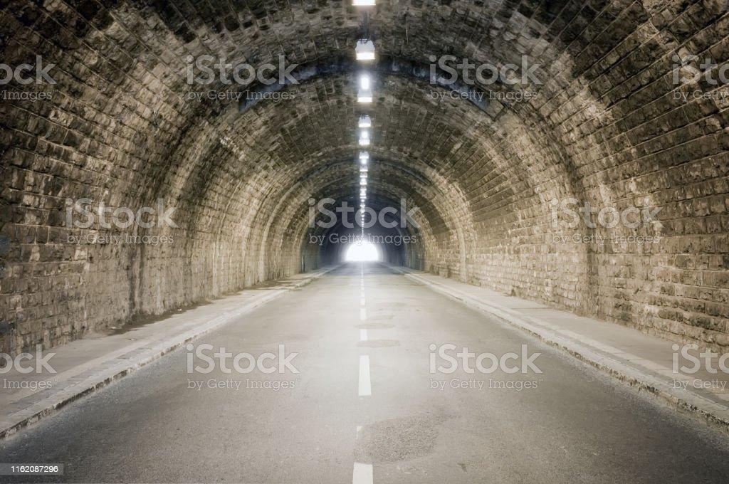 light at the dark tunnel vanishing point end