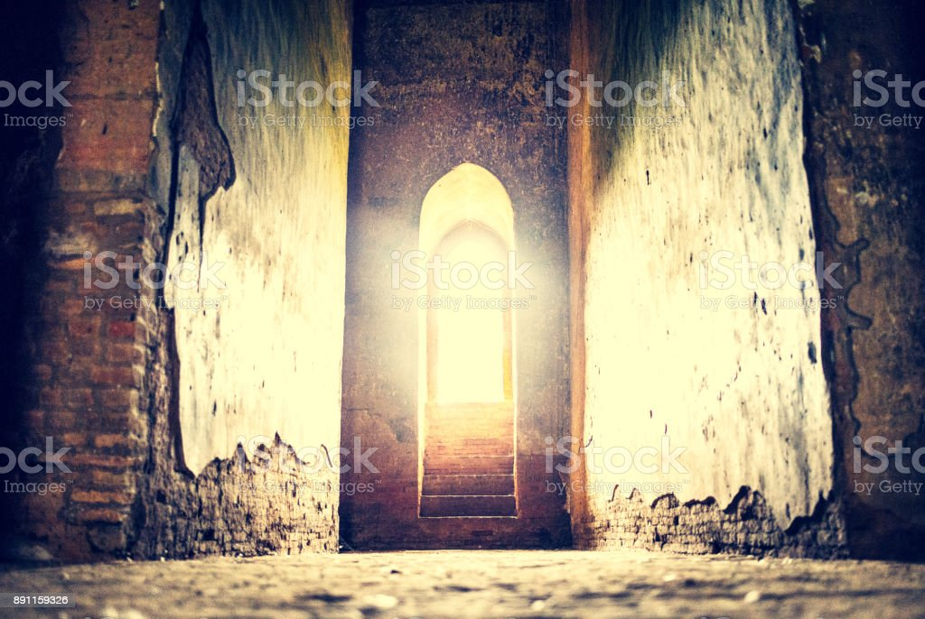 Light at the end of the tunnel concept with golden, glowing illumination stock photo