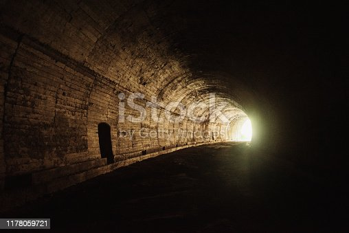 Desperate man sitting in the tunnel.