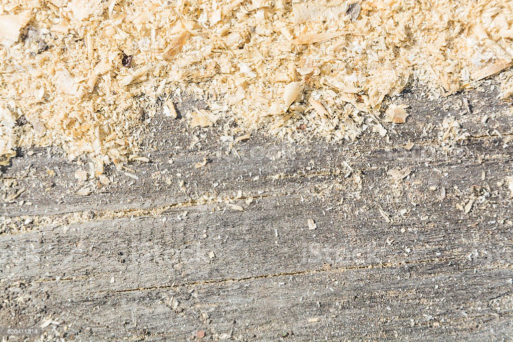 Light background, texture on wooden surface lie sawdust stock photo