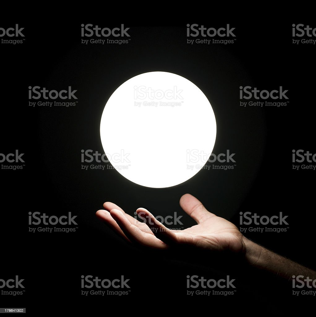 Light ball over human hand stock photo
