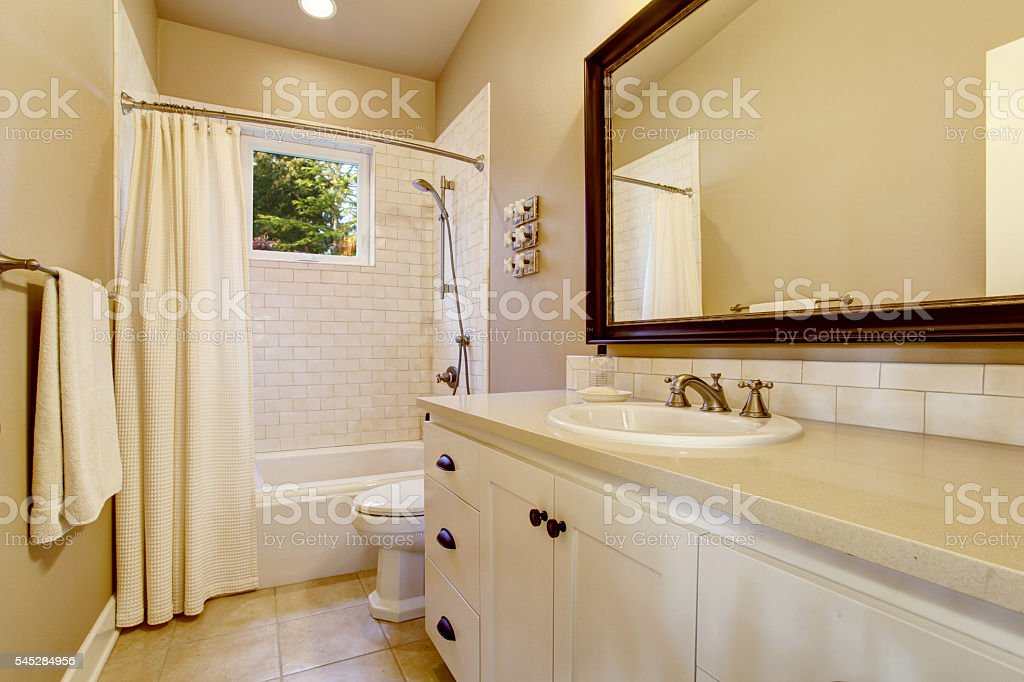 Light bathroom interior with white cabinet and shower – Foto